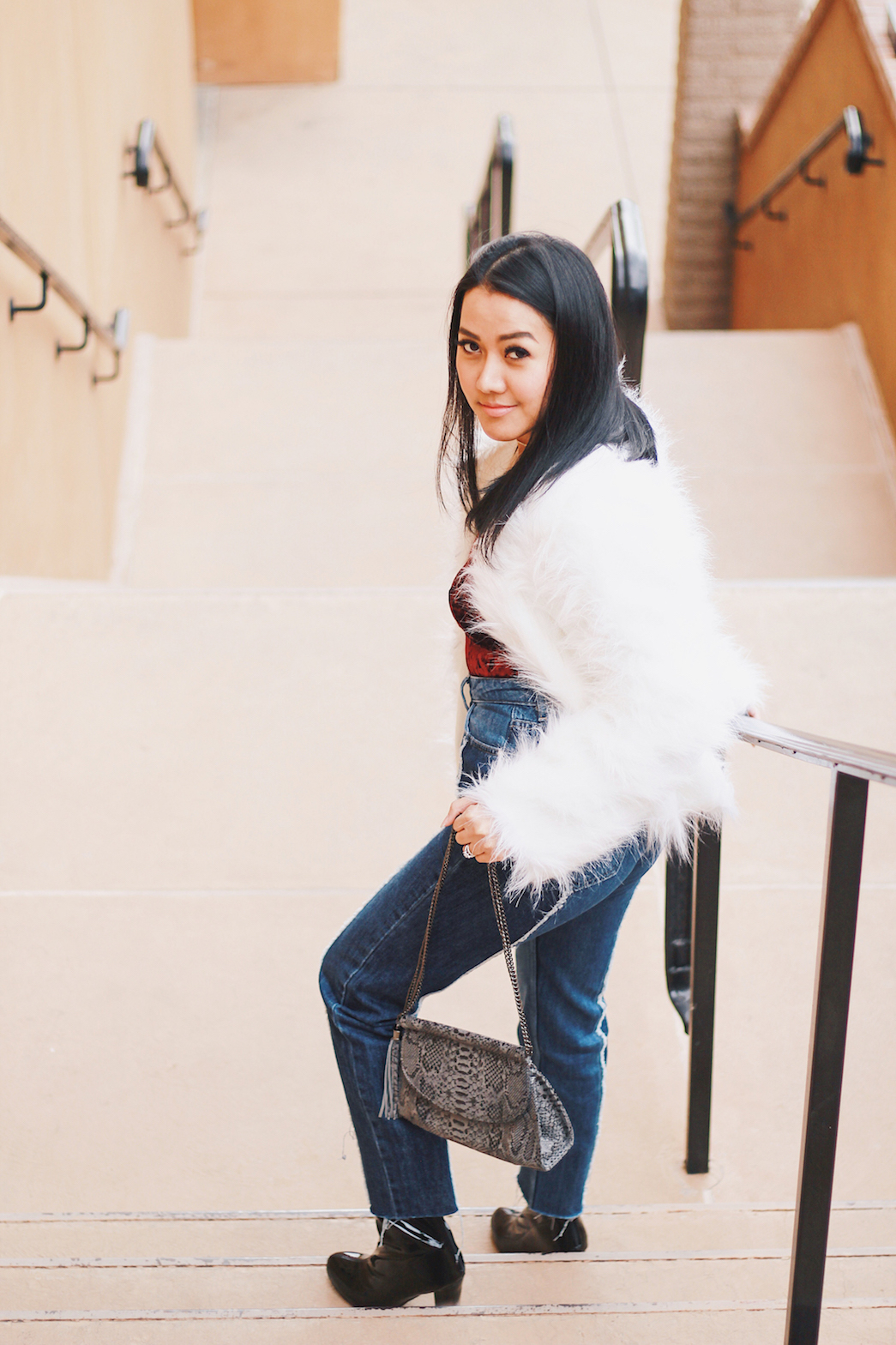 Holiday-Outfit-Ideas-Faux-Fur-Jacket-Velvet-Bodysuit-NA-KD-Jeans