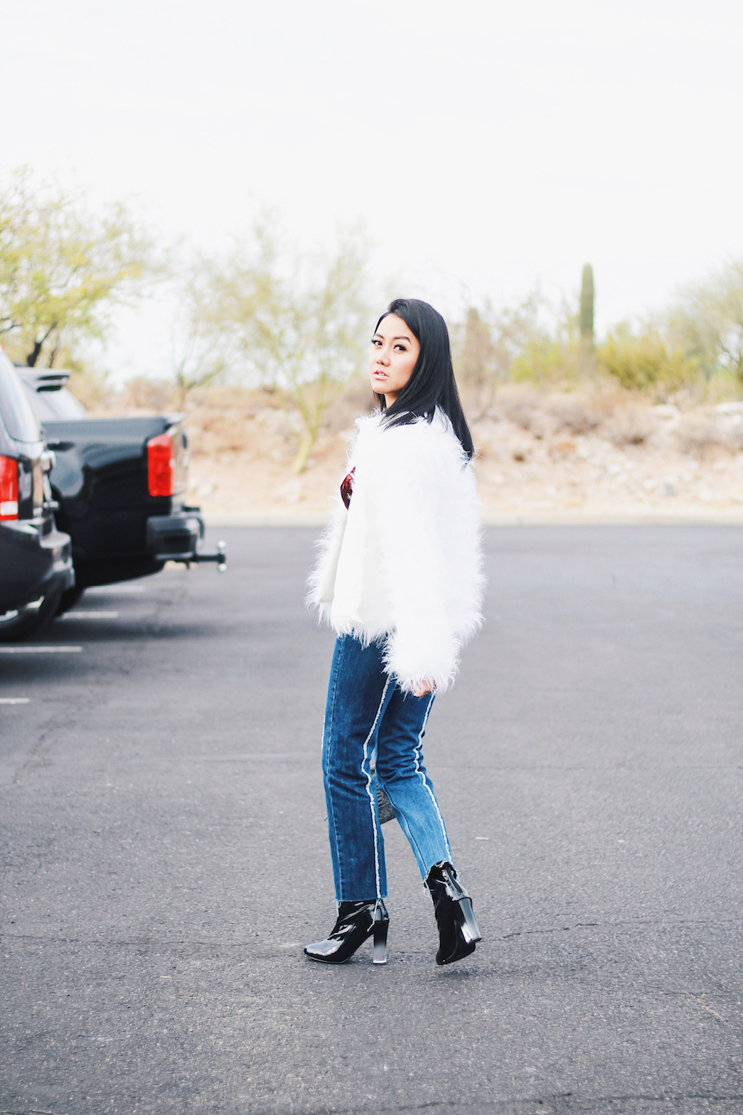 Holiday-Outfit-Ideas-Jeans-Faux-Fur-Jacket-Patent-Boots