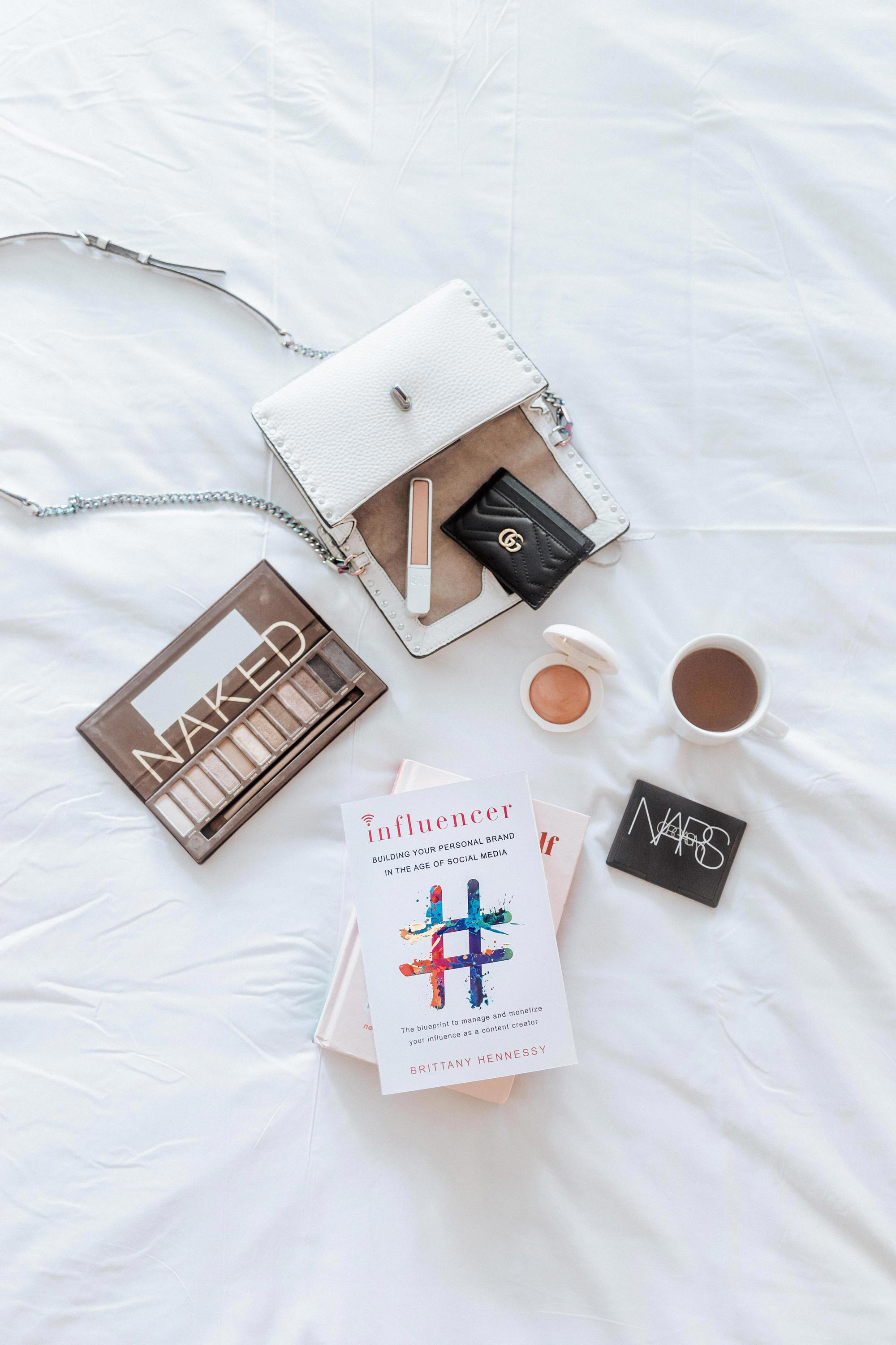 A-must-read-book-to-up-your-influencer-game_Molly-Larsen_Style-Blogger_Book-Flatlay_AllAboutGoodVibes.com_IG_@TheVibesCloset_Influencer-Building-Your-Personal-Brand-in-the-Age-of-Social-Media-by-Brittany-Hennessy