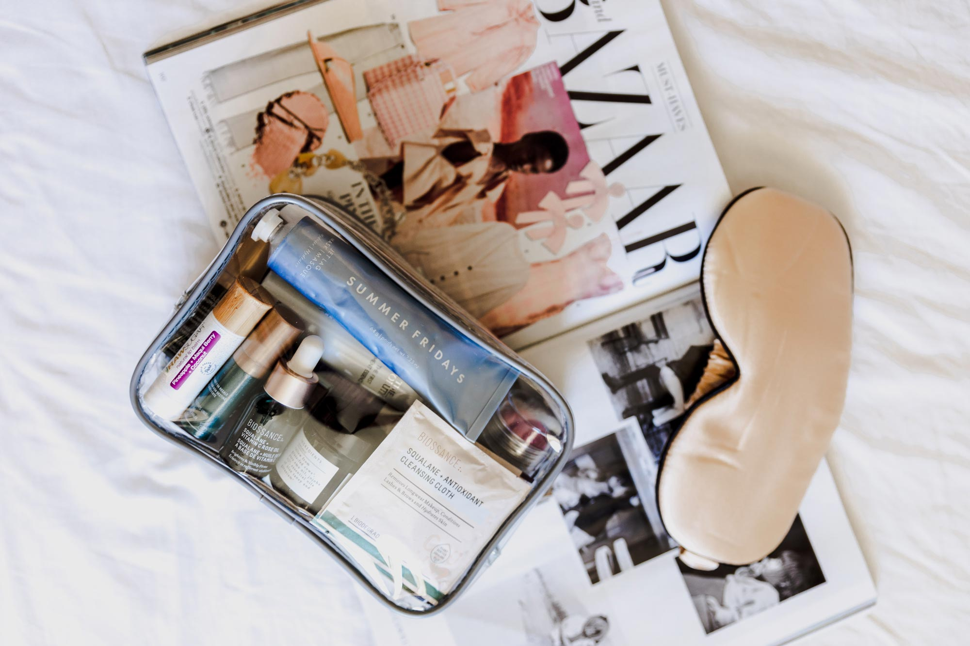 Holiday Trip | What's in my toiletry bag? Molly Larsen Beauty Style Blogger IG @thevibescloset Flatlay